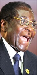 The Zimbabwean president, Robert Mugabe, reacts to his welcome at the  SADC summit in Lusaka, Zambia