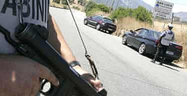 Carabinieri man a roadblock in the southern Italian town of San Luca after six people were killed in Duisberg, Germany