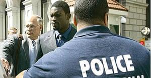 Atlanta Falcons quarterback Michael Vick leaves the federal courthouse in Richmond, Virginia, following his arraignment.