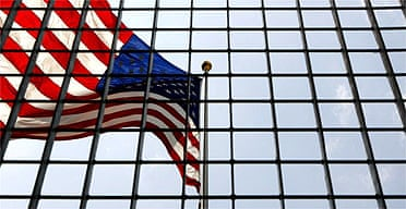 An American flag on the site of the World Trade Center is seen through a fence