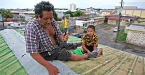 Roberto Pott and his grandson Zeine prepare for the arrival of Hurricane Dean in Belize City