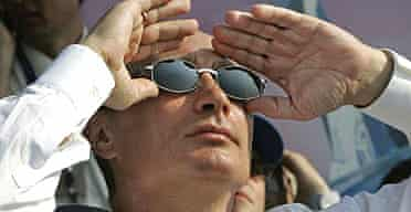 The Russian president, Vladimir Putin, watches a fly-past at the biggest air show in the country's post-Soviet history