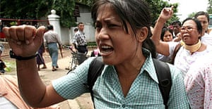 Burmese activists shout slogans during a protest in the capital, Rangoon