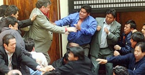 Bolivian opposition lawmakers clash with governmental counterparts during a session at the National Congress in La Paz