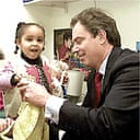 Tony Blair with an adopted child at the launch of adoption targets in 2000. Photograph: Press Association