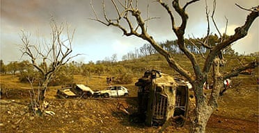A burnt-out fire truck and cars in village of Artemida in southern Greece