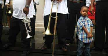 A young boy looks on after a parade drawing attention to the plight of musicians following Hurricane Katrina in New Orleans