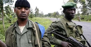 Congolese army soldiers guard the main road north from Goma, the capital of North Kivu province