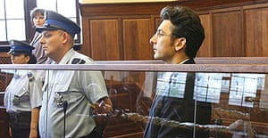 Author Krystian Bala listens as a court convicts him of directing the killing of a local businessman