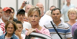 A crowd looks on as Kate McCann arrives at the police station in Portimao, southern Portugal