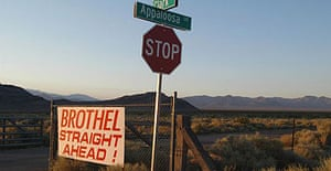 An advertisement for a brothel in the middle of the desert, about 70 miles north-west of Las Vegas