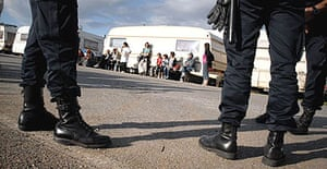 Gypsies and supporters facing evacuation from a makeshift camp in Vaulx-en-Velin, east of Lyon, in the run-up to the Rugby World Cup