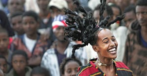 A member of the Circuscopia street theatre troupe performs in the streets of Addis Abeba as part of Ethiopia's millennium celebrations