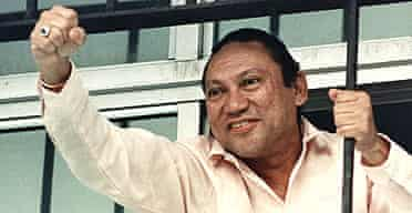 Manuel Noriega gestures through the barred windows of his command headquarters in Panama City after surviving a coup attempt in October 1989