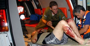 An injured Israeli soldier is evacuated after a rocket from the Gaza Strip hit an army base