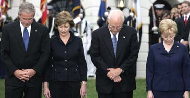 The US president, George Bush, the first lady, Laura Bush, the vice-president, Dick Cheney, and his wife Lynne, mark the sixth anniversary of the 9/11 attacks