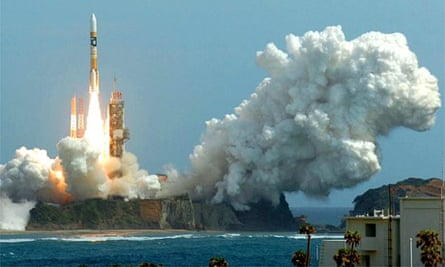 A rocket carrying a lunar probe lifts off from the Tanegashima space centre in Japan