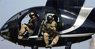 Members of Blackwater scan Baghdad from their helicopter