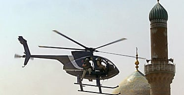 A Blackwater helicopter flying low in Baghdad