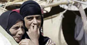 Iraqi Shiite women are seen in a camp outside of Najaf, 160 kilometers (100 miles) south of Baghdad, Iraq.