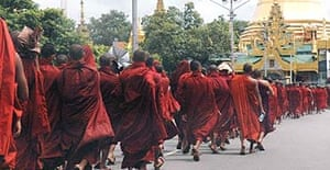 Monks march through the streets of Rangoon