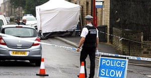 Police conduct an investigation at the scene in Royd Street, Slaithwaite, Huddersfield