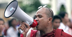 A Buddhist monk takes part in a peaceful protest in Burma