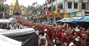 Buddhist monks take part in protests in Rangoon despite warnings from Burma's military junta of a crackdown