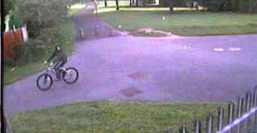 CCTV image of a boy on a BMX outside the Fir Tree pub in Liverpool