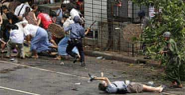 Kenji Nagai, a Japanese photographer with AFP, is shot by soldiers in Rangoon