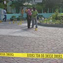 People stand near a mosque in Male in the Maldives.