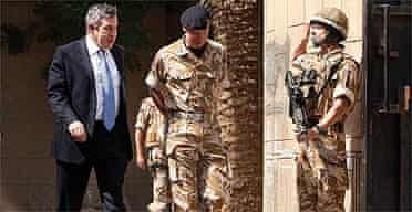 Gordon Brown (l) walks with Air Chief Marshall Sir Jock Stirrup, chief of the defence staff, in Baghdad
