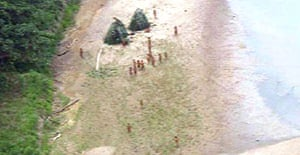 Twenty members of what is thought to be the Mascho Piro tribe, captured on film from a helicopter in the Peruvian national park of Alto Purus
