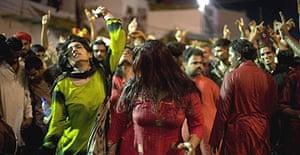 Women dance outside the 'golden gate' at the central shrine of the Sehwan Sharif festival in Pakistan