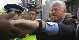 Bill Clinton shakes hands with people in the crowd as he leaves Waterstones in Regent Street, London where he was signing copies of his new book, How Each of Us Can Change the World.