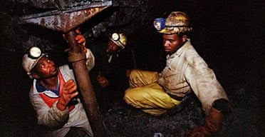 Miners work underground at the Harmony Goldmine, near Carletonville, South Africa.