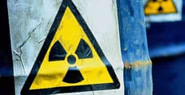 Blue drums displaying Radioactive sign.