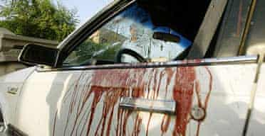 Blood stained and bullet riddled car