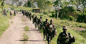 Soldiers from the Uganda People Defense Forces (UPDF) patrol near the border with Congo.