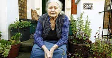 Doris Lessing outside her London home after learning she had won the Nobel prize for literature
