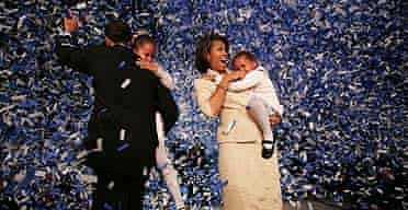 Barack Obama holding his daughter Malia, with wife Michelle and youngest daughter Sasha, in Chicago, after Obama won his Senate seat.