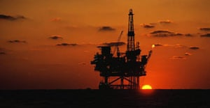 Oil platform in the Gulf of Mexico at sunset