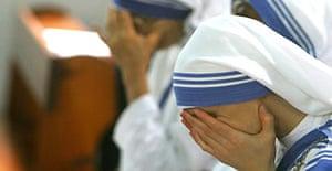 Nuns pray in the Deir al-Lateen Catholic church in Gaza City