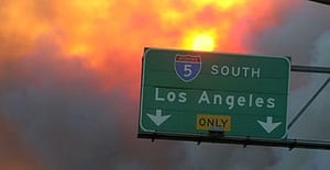 Fire surrounds the main road at Stevenson Ranch, southern California