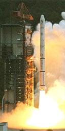 The rocket carrying China's Change 1 moon probe takes off from Sichuan province. Photograph: Wang Jianmin/Xinhua/AP