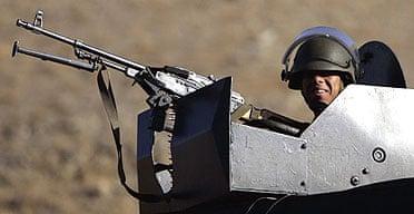 A Turkish soldier on watch near the Turkey-Iraq border