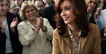 Argentina's presidential candidate of the ruling Frente Para la Victoria party, Cristina Fernandez de Kirchner, right, casts her vote