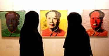 Iranian women look at Warhol's Mao Zedong in Tehran's Museum of Contemporary Art