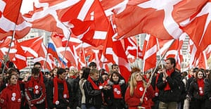 """Members of the pro-Kremlin youth group """"Nashi"""" (Ours) wave flags during a demonstration in Moscow"""