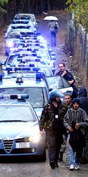 Italian police arrive at the shantytown in Rome where the suspect lived with his mother